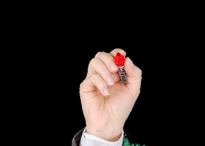 Hand som håller i röd penna.